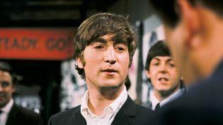 John Lennon en studio en 1964.  (KIPPA / ANP MAG / ANP/AFP)
