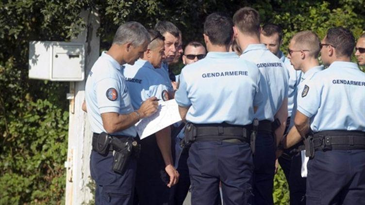 Des gendarmes sur le terrain d'une enquête criminelle (archive) (AFP/JEAN-SEBASTIEN EVRARD)