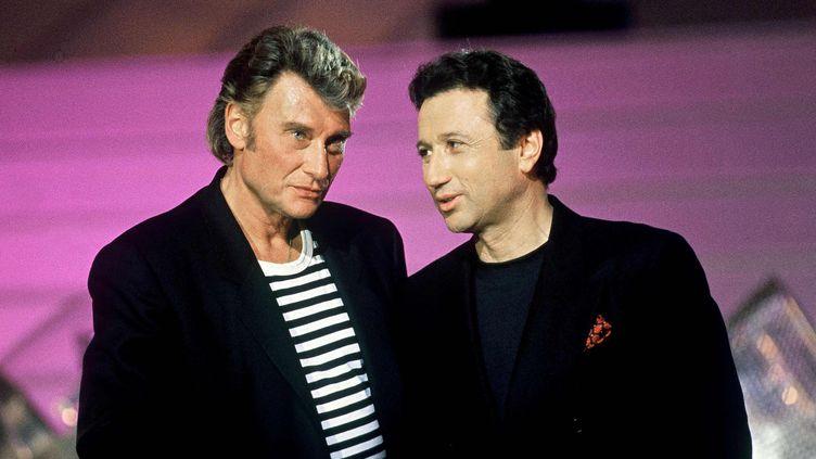 Johnny Hallyday et Michel Drucker, le 27 janvier 1992. (HAROT/TF1/SIPA)