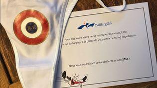 Capture d'une photo publiée sur Twitter, montrant le string envoyé à tous les habitants de la ville de Baillargues (Hérault) par le maire de la commune, en décembre 2017. (CAPTURE D'ECRAN TWITTER)