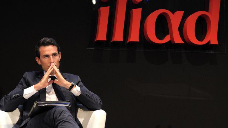 Le directeur financier du groupe Iliad Thomas Reynaud le 2 septembre 2013, à Paris, lors d'une conférence de presse. (ERIC PIERMONT / AFP)