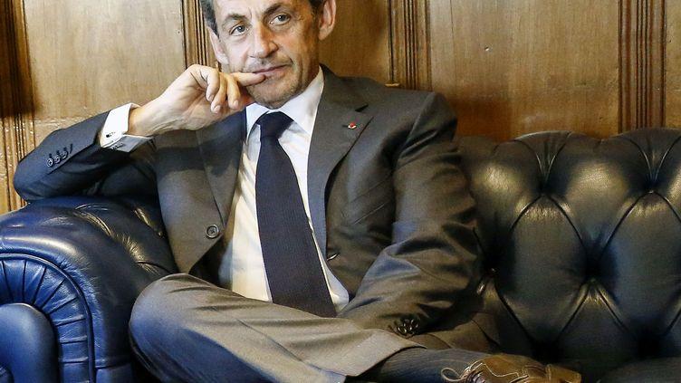 L'ancien président de la République, Nicolas Sarkozy, le 26 août 2015, à Sao Paulo (Brésil). (MIGUEL SCHINCARIOL / AFP)
