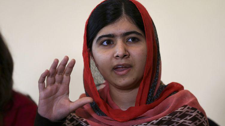 La Pakistanaise Malala Yousafzai,lors d'un rassemblement pour les lycéennes enlevées au Nigeria, le 13 juillet 2014, à Abuja (Nigeria). La jeune filleparticipe au Girl Summit 2014, organisé à Londres (Royaume-Uni). (AFOLABI SOTUNDE / REUTERS)