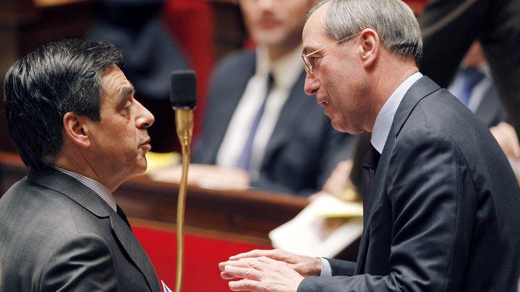 François Fillon (à gauche) et Claude Guéant, le 21 février 2012. (PATRICK KOVARIK / AFP)