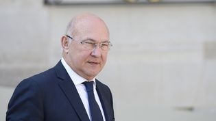 Michel Sapin devant l'Elysée, le 12 mars 2014. (ALAIN JOCARD / AFP)