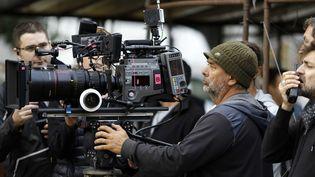 """Le cinéaste Luc Besson, ici pendant le tournage de """"Lucy"""" en 2014.  (LILO/SIPA)"""