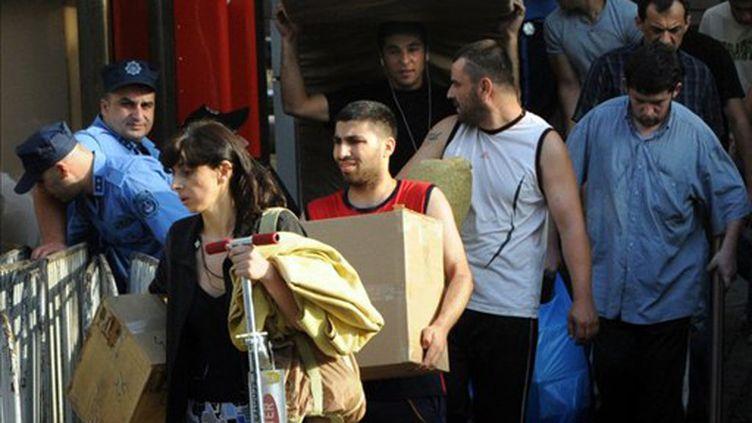 Des réfugiés de guerre des minorités abhkazes et d'Ossétie du sud évacués de Tbilissi le 15 août 2011 (AFP/VANO SHLAMOV)