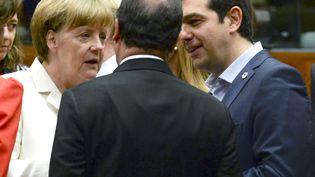 Angela Merkel, François Hollande (de dos) et Alexis Tsipras, le 12 juillet 2015, à Bruxelles (Belgique). (  REUTERS)