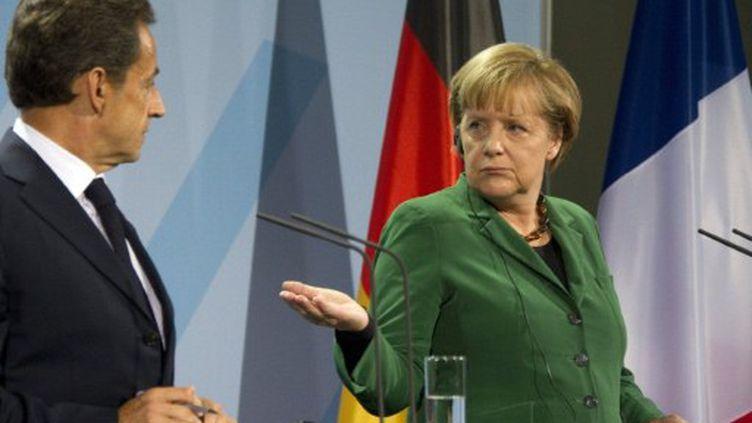Nicolas Sarkozy et Angela Merkel (octobre 2011) (ODD ANDERSEN / AFP)