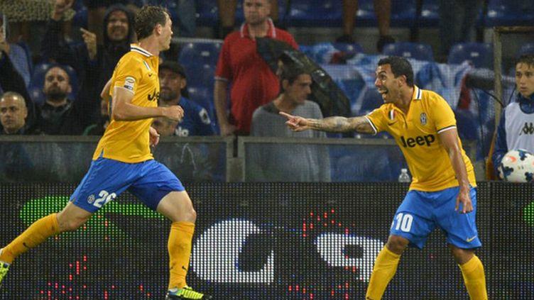 Carlos Tevez fête son deuxième but sous les couleurs de la Vieille Dame (ANTONIN THUILLIER / AFP)