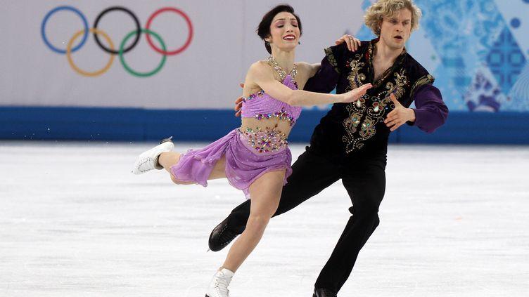 Charlie White et Meryl Davis lors de leur sacre olympique à Sotchi en 2014 (POOL / KMSP)