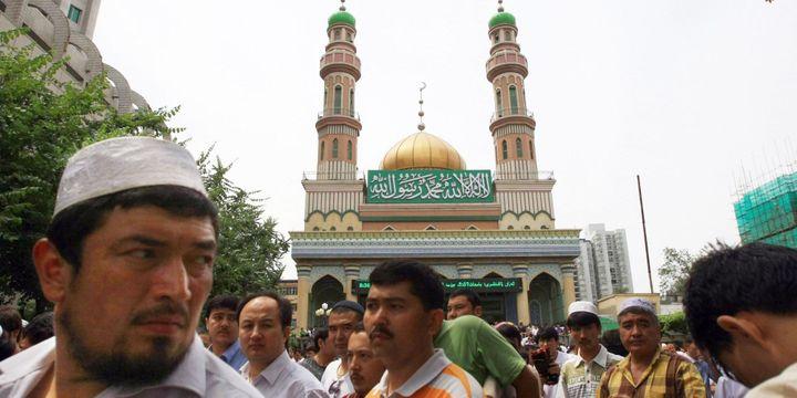 Des musulmans ouïgours à Urumqi, capitale du Xinjiang (Chine) (STR / ZH0027 / AFP CHINA XTRA)