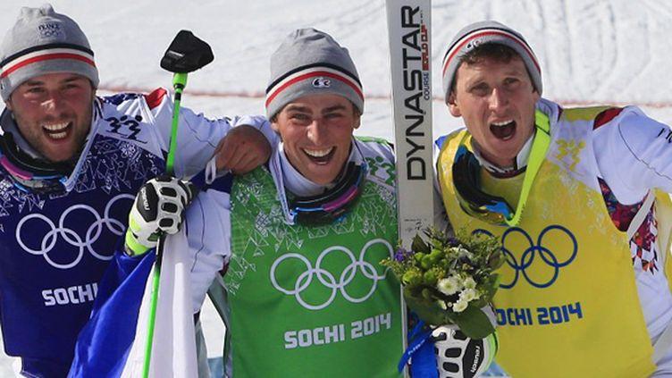 Chapuis Bovolenta et Midol sur le podium du Skicross (ALEXANDER KLEIN / AFP)