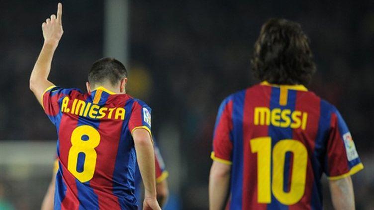 Andres Iniesta  et Lionel Messi (FC Barcelone)