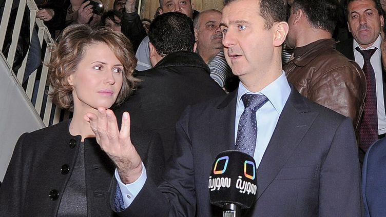 Bachar Al-Assad et son épouse Asma, le 26 février 2012. (AFP / SANA)