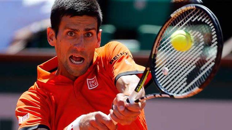 (Le N.1 mondial Novak Djokovic a battu samedi l'Ecossais Andy Murray (N.3) en deux jours et en cinq manches 6-3, 6-3, 5-7, 5-7, 6-1 pour accéder à sa troisième finale à Roland-Garros © Maxppp)