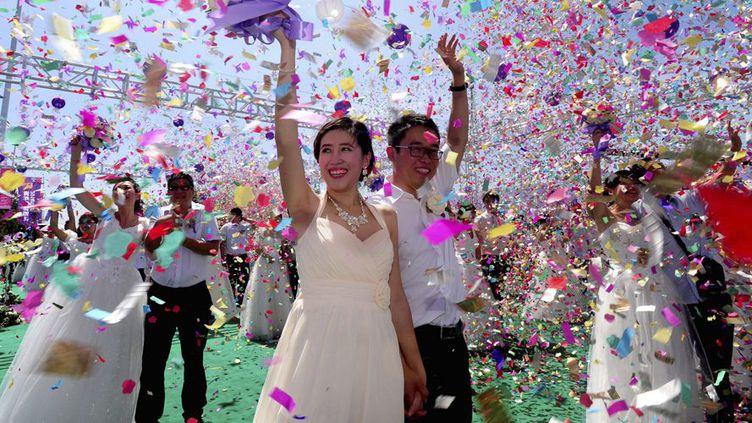 Mariages collectifs à Shenyang le 2 août 2014 à l'occasion du Qixi Festival ( fête de l'amour) (Reuters/Stringer)