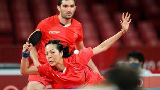 La paire française Emmanuel Lebesson-Yuan Jia Nan lors du tournoi olympique de Tokyo, le 25 juillet 2021. (ZHENG HUANSONG / XINHUA / AFP)