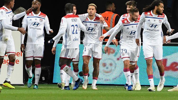 La joie des joueurs de Lyon  (FRED TANNEAU / AFP)