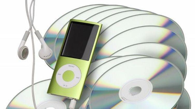 CDs et lecteur numérique  (Charlie Abad / Photononstop / AFP)