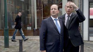 François Hollande et le maire de Tulle (Corrèze), Bernard Combes, également conseiller à l'Elysée, le 25 mai 2014. (ALAIN JOCARD / AFP)