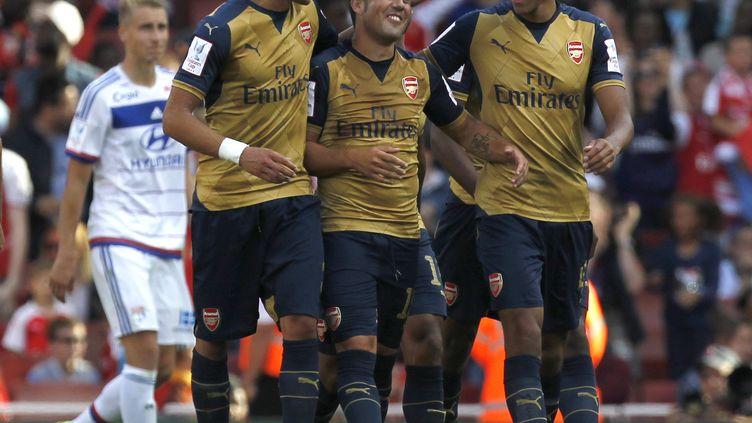 La joie des joueurs d'Arsenal, faciles vainqueurs des Lyonnais (IAN KINGTON / AFP)