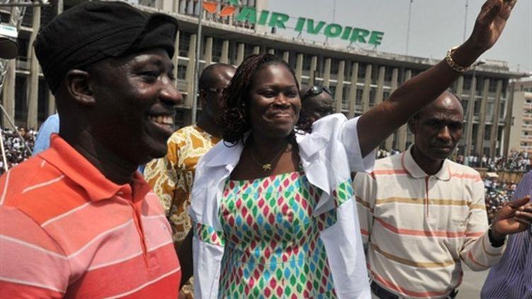 Charles Blé Goudé (à gauche) et Simone Gbagbo, la femme de l'ancien président ivoirien, le 5 février 2011 à Abidjan. (AFP/ISSOUF SANOGO)