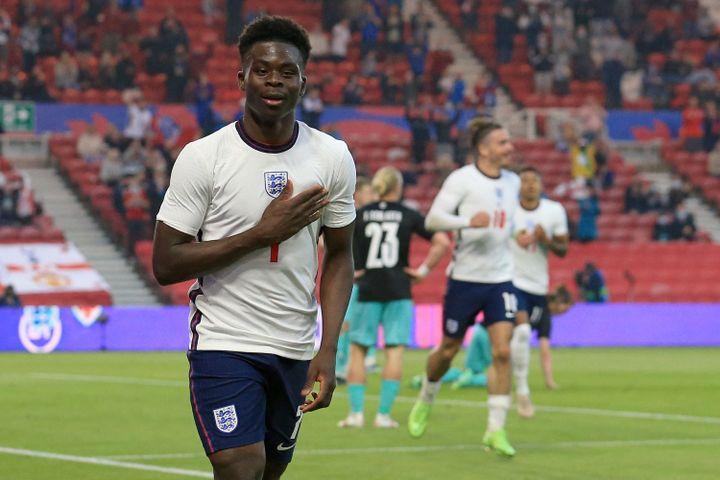 Bukayo Saka, l'un des jeunes joueurs de l'équipe d'Angleterre à suivre, ici après son but face àl'Autriche, le 2 juin (LINDSEY PARNABY / POOL)