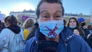 Rosalie, 68 ans, participe à la marche des libertés, à Paris samedi 28 novembre 2020. (BORIS LOUMAGNE / RADIO FRANCE)