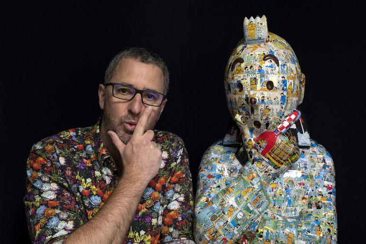 L'artiste Christophe Tixier, alias Peppone, pose à côté d'une de ses oeuvres à La Roque d'Antheron, le 13 avril 2021. (CHRISTOPHE SIMON / AFP)