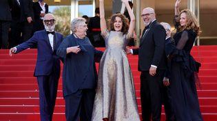 """L'équipe du film """"Aline"""" sur les marches de Cannes (VALERY HACHE / AFP)"""