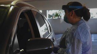 Un automobiliste participe à un dépistage du coronavirus à Seattle, aux Etats-Unis, le vendredi 6 mars 2020. (AFP)