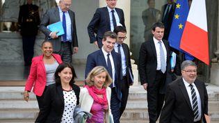 Les ministres Christiane Taubira, Cécile Duflot, Hélène Conway, Arnaud Montebourg, Benoît Hamon, Manuel Valls et Alain Vidalies quittent l'Elysée, le 6 mai 2013. (MARTIN BUREAU / AFP)