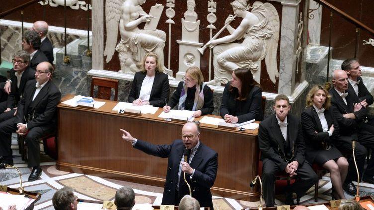 Le ministre du Budget, Bernard Cazeneuve, le 19 novembre 2013 à l'Assemblée nationale, à Paris. (ERIC FEFERBERG / AFP)