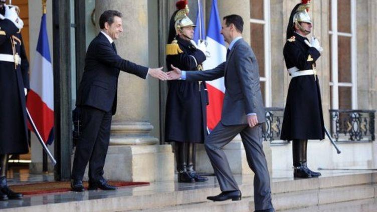 Le président syrien Assad en visite à Paris en décembre 2010 (AFP/FRANCK FIFE)