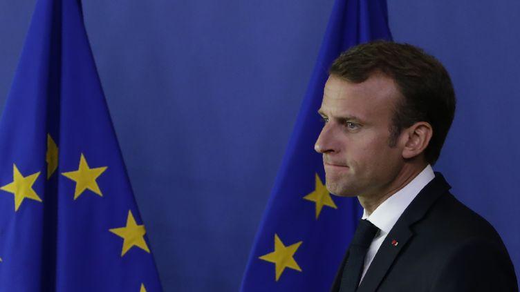 Emmanuel Macron à l'issue du mini-sommet de crise consacré aux migrants organisé à Bruxelles (Belgique), dimanche 24 juin 2018. (ARIS OIKONOMOU / AFP)