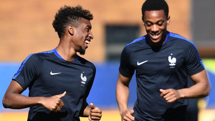 Les footballeurs Kinglsey Coman et Anthony Martial, le 6 juillet 2016 à Marseille (Bouches-du-Rhône). (FRANCK FIFE / AFP)