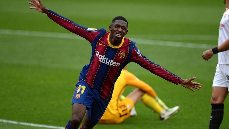 Ousmane Dembélé célèbre son but face à Séville, le 27 février 2021 (CRISTINA QUICLER / AFP)