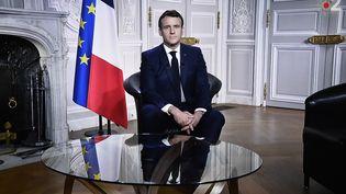 Emmanuel Macron a prononcé ses voeux depuis l'Elysée, jeudi 31 décembre 2020. (STEPHANE DE SAKUTIN / AFP)