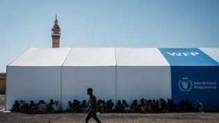 Des réfugiés de la région éthiopienne du Tigré sont accueillis par leProgramme alimentaire mondial de l'ONU àGedaref, au Soudan. (YASUYOSHI CHIBA / AFP)