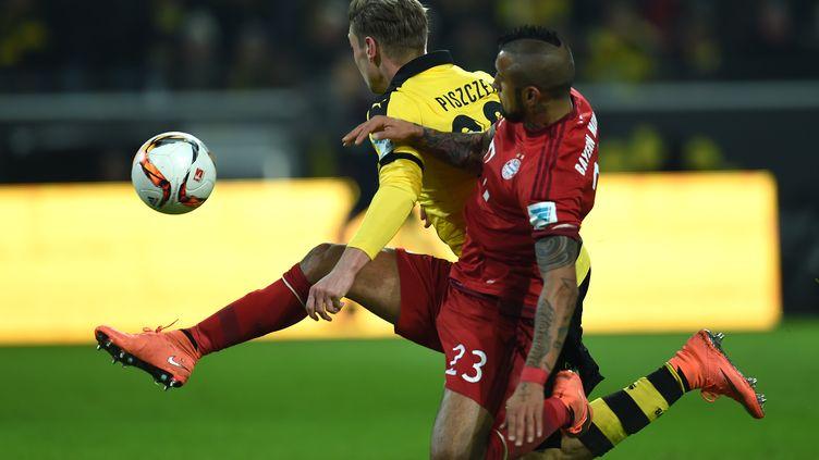 Le Borussia Dortmund et le Bayern Munich se livrent un gros duel en Bundesliga (PATRIK STOLLARZ / AFP)