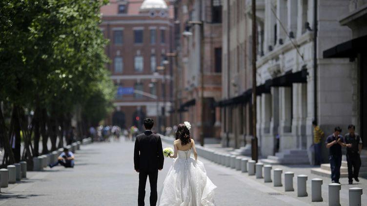 A Shanghai, des couples, même heureux, divorcent pour mieux investir dans l'immobilier (EUGENE HOSHIKO/AP/SIPA / AP)