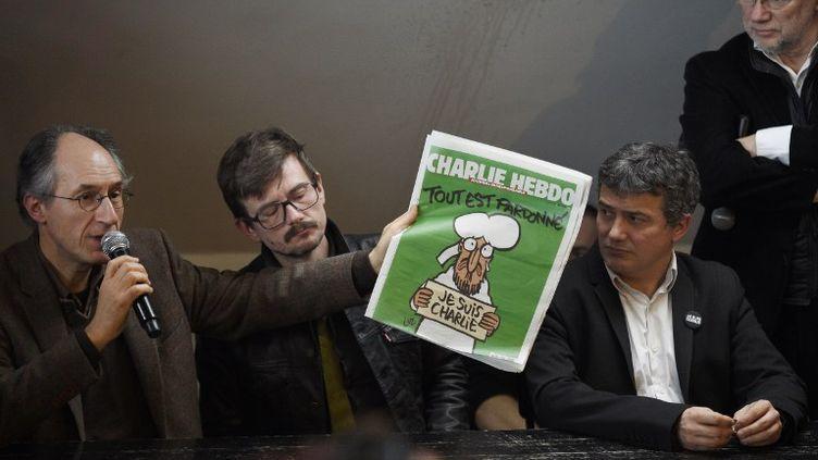 """La rédaction de """"Charlie Hebdo"""" tient une conférence de presse à Paris, mardi 13 janvier 2015. (MARTIN BUREAU / AFP)"""