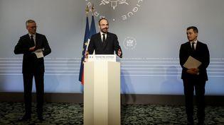 Le ministre de l'Economie, Bruno Le Maire, le Premier ministre, Edouard Philippe, et le ministre de l'Action et des Comptes publics, Gérald Darmanin, à Paris, le 19 mars 2020. (LUDOVIC MARIN / AFP)