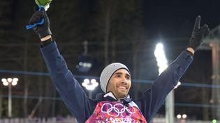 Martin Fourcade est devenu, lundi 10 février, champion olympique de poursuite aux JO 2014 de Sotchi (Russie). (ALBERTO PIZZOLI / AFP)