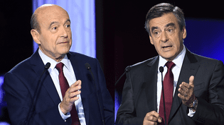 Alain Juppé et François Fillon lors d'un débat télévisé avant le premier tour de la primaire à droite, le 3 novembre 2016. (AFP)