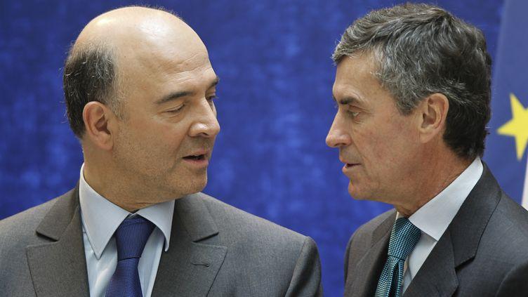 Les ministres de l'Economie, Pierre Moscovici,et du Budget,Jérôme Cahuzac, le 17 mai 2012 à Paris. (CHARLES PLATIAU / REUTERS)