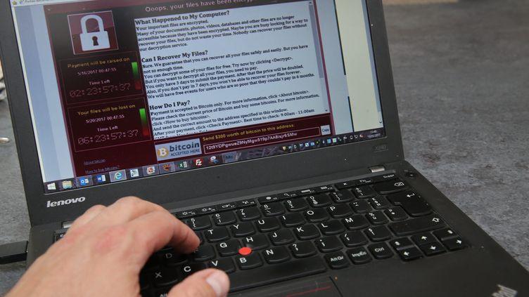 Un écran piraté lors de la cyberattaque contre Microsoft, le 15 mai 2017. (JEAN-FRANÇOIS FREY / MAXPPP)