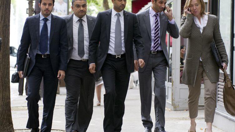 Nasser Al-Khelaifi (C), le président du PSG et d'Al-Jazira Sport, le 13 juillet 2011 à Paris. (FRED DUFOUR / AFP)