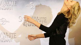 Le photocall façon Charlize Theron, c'est toujours renversant. (MICHELE TANTUSSI / AFP)